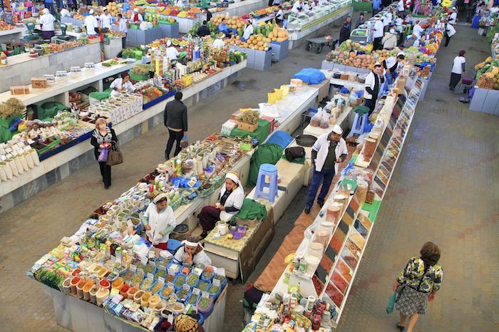 "Ashgabad, Turkmenistan - October 10, 2014. Farmers Market ""Gulistan"" in Ashgabad on October 10, 2014. People at closed market in Ashgabad, Turkmenistan"