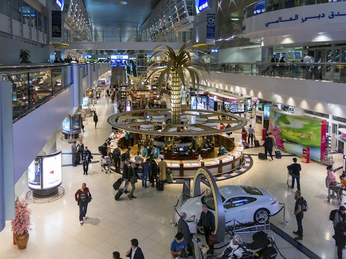 Shopping center in hall of terminal of Dubai International Airport, United Arab Emirates